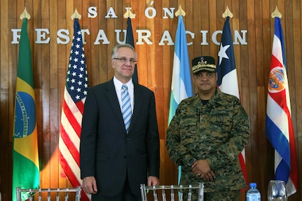 Robert E. Copley, Deputy Chief of Mission at the U.S. Embassy in Santo Domingo, Dominican Republic, poses alongside Brig. Gen. Juan Manuel Mendez Garcia, director of the Emergency Operations Center for the Dominican Republic.
