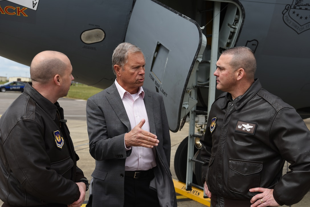 Retired U.S. Air Force Gen. William Fraser, former commander of U.S. Transportation Command and senior fellow for the National Defense University, center, speaks with Col. Cassius Bentley, 100th Air Refueling Wing vice commander, and Col. Bob Shelton, 100th Operations Group commander, at RAF Mildenhall, England, May 6, 2019. Members of the European Command Capstone 19-3 class visited Airmen of the 100th ARW, 352d Special Operations Wing and tenant units on base. (U.S. Air Force photo by Airman 1st Class Brandon Esau)