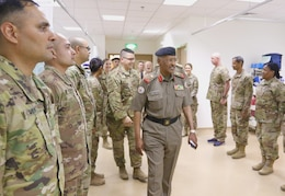 Maj. Gen. Ibrahim Alameeri, head of Medical Health Authority, Kuwait Land Forces, walks into the surgical suite of United States Military Hospital-Kuwait, at Camp Arifjan, Kuwait, May 5, 2019.