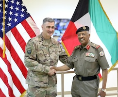U.S. Army Brig. Gen. Clint E. Walker, commanding general of 184th Sustainment Command, stands with Maj. Gen. Ibrahim Alameeri, head of Medical Health Authority-Kuwait, at Camp Arifjan, Kuwait, May 5, 2019.