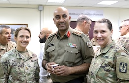 Hospital, Col. Nawaf Al-Dosari, M.D., director of the North Military Medical Complex, and Col. Kathleen Clary, 452d CSH, stand together at Camp Arifjan, Kuwait, May 5, 2019.