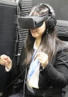 DECA staff member Lilly Zhu tests the Army's Decide to Lead exhibit during the DECA Conference in Orlando.