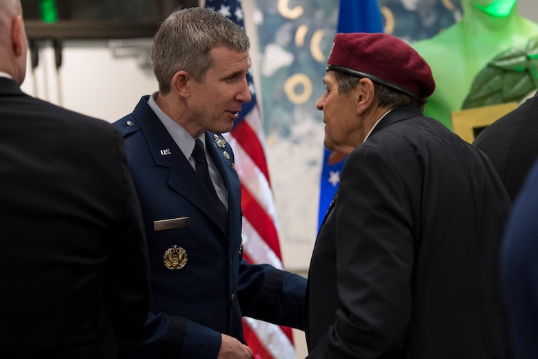 Brig. Gen. Thomas Kunkel, chief Air Force legislative liason to the U.S. House of Representatives, speaks with a member of the Jolly Green Association (JGA) during the banquet celebrating the 50th reunion of the JGA, May 4, 2019, in Fort Walton Beach, Fla. The JGA presented Airmen from the 41st Rescue Squadron (RQS) and the 48th RQS with the Rescue Mission of the Year award; the only non Air Force award recognized by the Air Force. (U.S. Air Force Photo by Staff Sgt. Janiqua P. Robinson)