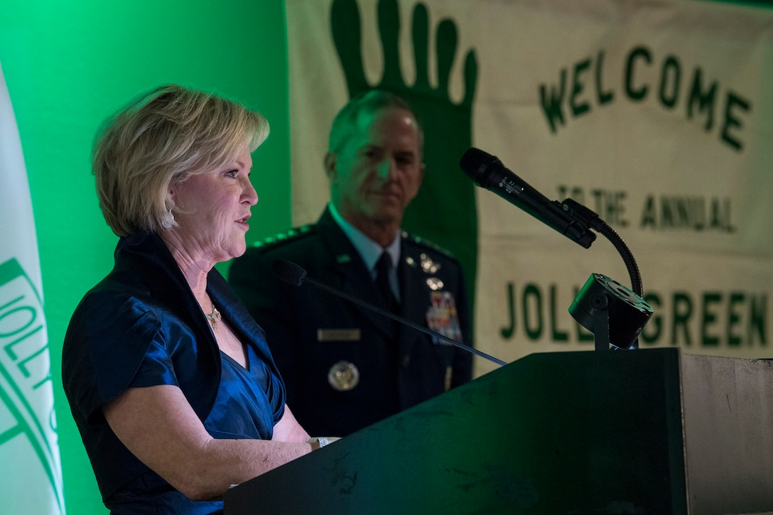 Dawn Goldfein thanks past and present members of the rescue community for their bravery as Air Force Chief of Staff Gen. David L. Goldfein listens, during the banquet celebrating the 50th reunion of the Jolly Green Association (JGA), May 4, 2019, in Fort Walton Beach, Fla. The JGA presented Airmen from the 41st Rescue Squadron (RQS) and the 48th RQS with the Rescue Mission of the Year award; the only non Air Force award recognized by the Air Force. Mrs. Goldfein spoke from her perspective as a spouse after Gen. Goldfein was shot down over Serbia on May 2, 1999. (U.S. Air Force Photo by Staff Sgt. Janiqua P. Robinson)