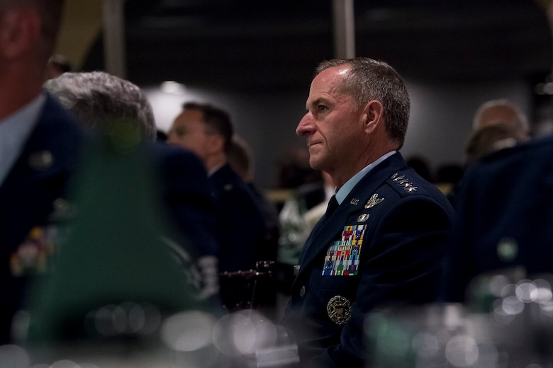Air Force Chief of Staff Gen. David L. Goldfein listens to remarks during the banquet celebrating the 50th reunion of the Jolly Green Association (JGA), May 4, 2019, in Fort Walton Beach, Fla. The JGA presented Airmen from the 41st Rescue Squadron (RQS) and the 48th RQS with the Rescue Mission of the Year award; the only non Air Force rescue award recognized by the Air Force. (U.S. Air Force Photo by Staff Sgt. Janiqua P. Robinson)