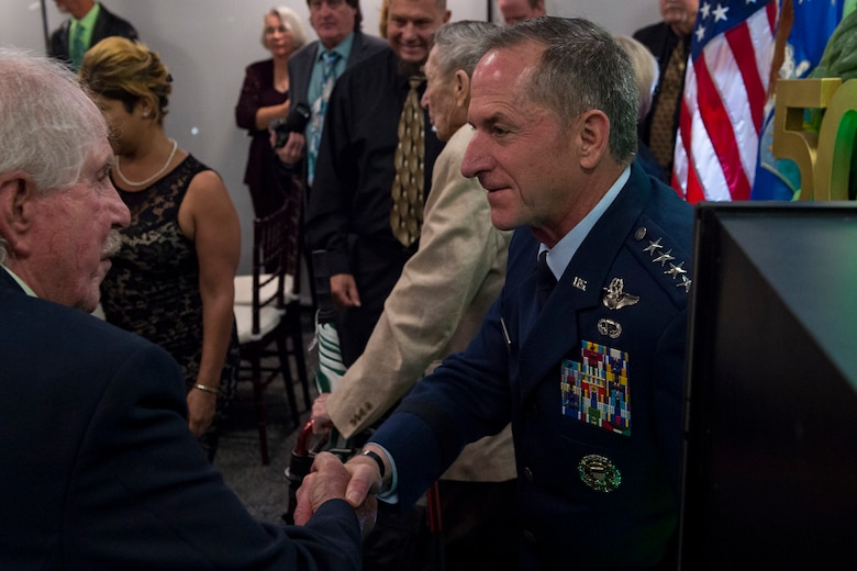 Air Force Chief of Staff Gen. David L. Goldfein, right, speaks with a member of the Jolly Green Association (JGA) during the banquet celebrating the 50th reunion of the JGA, May 4, 2019, in Fort Walton Beach, Fla. The JGA presented Airmen from the 41st Rescue Squadron (RQS) and the 48th RQS with the Rescue Mission of the Year award; the only non Air Force rescue award recognized by the Air Force. (U.S. Air Force Photo by Staff Sgt. Janiqua P. Robinson)