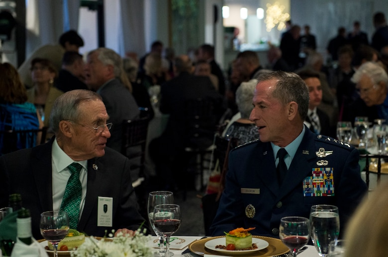 Air Force Chief of Staff Gen. David L. Goldfein, right, speaks with Barry Kamhoot, former Jolly Green Association (JGA) president, during the JGA 50th reunion banquet, May 4, 2019, in Fort Walton Beach, Fla. The JGA presented Airmen from the 41st Rescue Squadron (RQS) and the 48th RQS with the Rescue Mission of the Year award; the only non Air Force rescue award recognized by the Air Force. (U.S. Air Force Photo by Staff Sgt. Janiqua P. Robinson)
