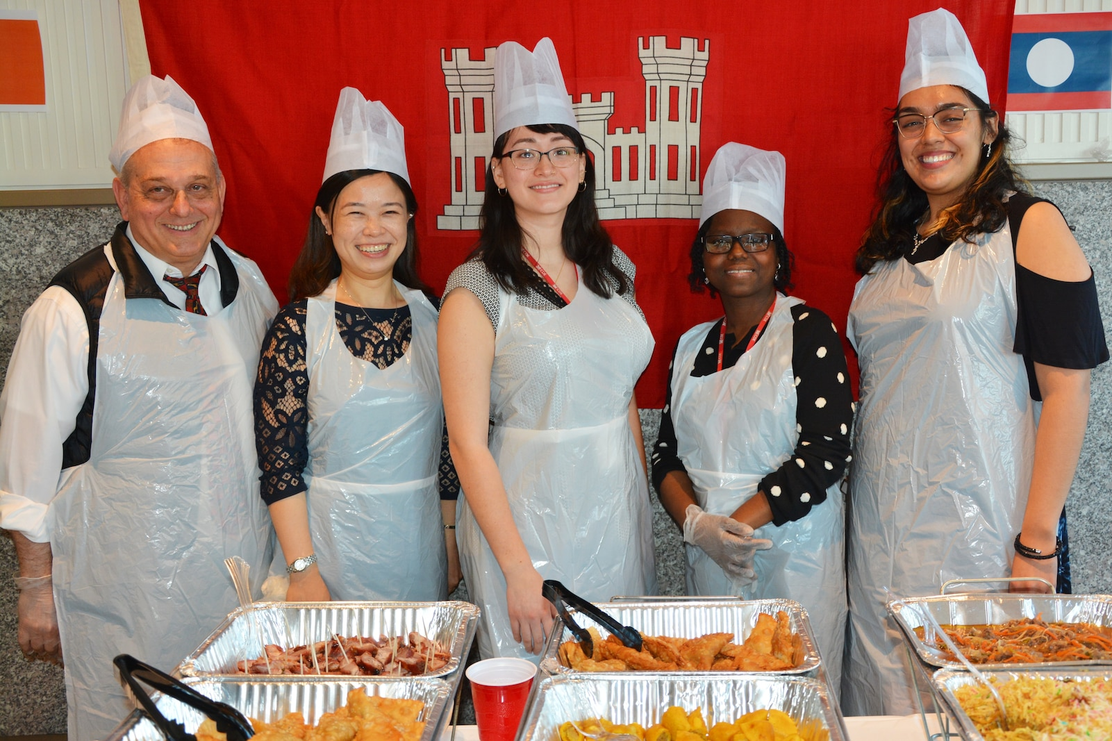 District personnel serve food at New York District's Diversity Day.