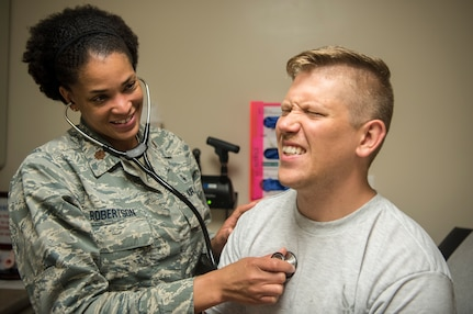 Maj. Erika Robertson, 628th Medical Operations Squadron family health nurse practitioner, listens to the heart of a simulated patient May 7, 2019, at Joint Base Charleston's 628th Medical Group.