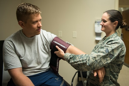 Senior Airman Samantha Thompson, 628th Medical Operations Squadron family health medical technician, places a blood pressure cuff onto a simulated patient May 7, 2019, at Joint Base Charleston's 628th Medical Group.