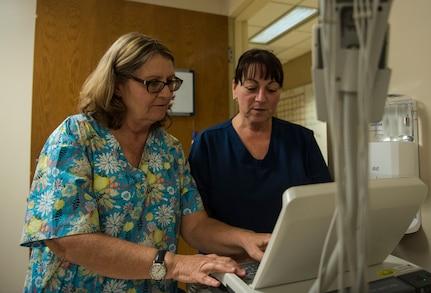 Marie Allen, left, 628th Medical Operations Squadron family health registered nurse works alongside Candy Dybowski, right, 628th Medical Operations Squadron Family Health licensed practical nurse, May 7, 2019, at Joint Base Charleston's 628th Medical Group.