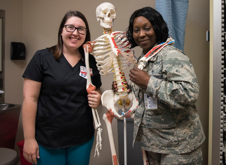 Amber Garren, left, 628th Aerospace Medical Squadron flight medicine nurse, stands with Capt. Tomeka Jones, 628th Aerospace Medical Squadron Flight Medicine nurse, May 7, 2019, at Joint Base Charleston's 628th Medical Group.