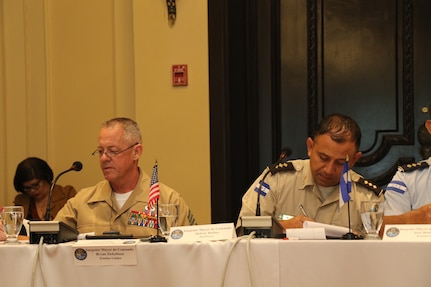 Multinational military members discuss cooperation during a gathering of U.S. and Central American senior enlisted leaders.