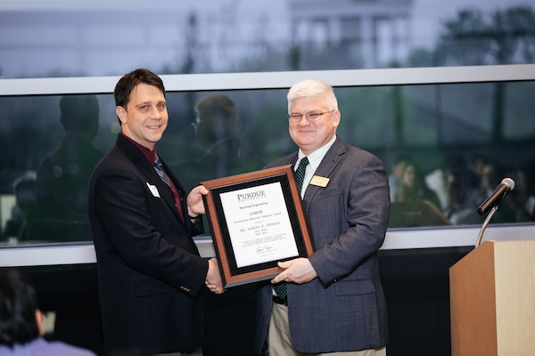 Dr. Aaron Pedigo, a Materials Engineer at NSWC Crane, was recognized with the Outstanding Materials Engineer (OMSE) award for demonstrating exemplary accomplishments and leadership in his field.