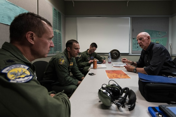 Terry Messer, a C-130 instructor pilot at the Dobbins Eastern Regional Flight Simulator, briefs a 757th Airlift Squadron flight-crew on the simulation they are about to participate in on April 24, 2019, at Dobbins Air Reserve Base, Georgia.