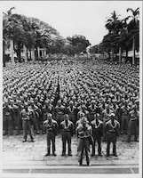 The 442nd Regimental Combat Team, made up of Japanese-American soldiers, stands in formation at Iolani Palace, Hawaii, prior to a departure for training, March 1943. The month of May is designated as Asian American and Pacific Islander Heritage Month in the U.S. This monthlong observance celebrates the achievements and contributions of Asian Americans and Pacific Islanders in the U.S. and recognizes the hardships and challenges they endured.