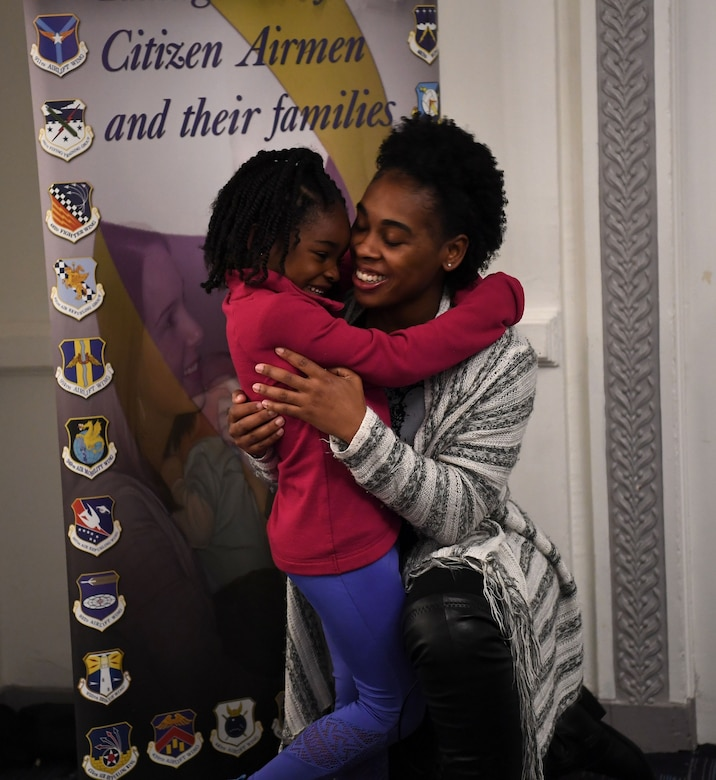 Tech. Sgt. Jocilyn Grable hugs her daughter April 26, 2019, during a Yellow Ribbon Reintegration Program training weekend in Chicago. Grable is the 507th Air Refueling Wing Development and Training Flight program manager at Tinker Air Force Base, Oklahoma. (U.S. Air Force photo by Tech Sgt. Samantha Mathison)