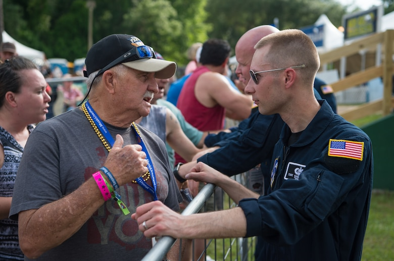 Technical Sgt. Gabriel Staznik, drummer with Max Impact, visits with fans after performing at the Armed Forces Tribute for the 2019 Suwannee River Jam. This event took place at the Spirit of the Suwannee Music Park on Saturday, May 4, 2019. (U.S. Air Force Photo by Chief Master Sgt. Kevin Burns)