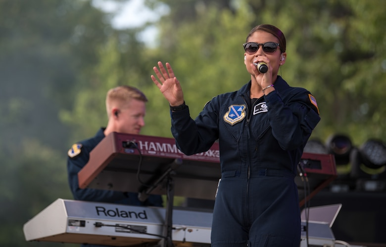 Lead vocalist for Max Impact, Technical Sgt. Nalani Quintello, performs at the Armed Forces Tribute during the 2019 Suwannee River Jam. This event took place at the Spirit of the Suwannee Music Park on Saturday, May 4, 2019. (U.S. Air Force Photo by Chief Master Sgt. Kevin Burns)