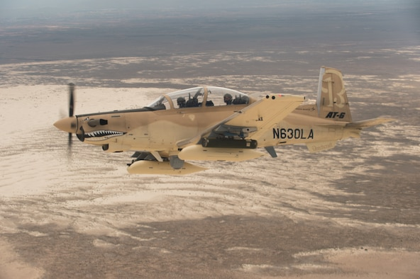 A Beechcraft AT-6B Wolverine experimental aircraft flies over White Sands Missile Range, N.M., July 31, 2017. Aircraft like the Wolverine and Embraer A-29 Super Tocano provide close-air support to U.S. allies and partners, and can also be outfitted with commercial off-the-shelf command and control units like the Airborne Extensible Relay Over-Horizon Network, or AERONet, increasing their combat effectiveness. (U.S. Air Force photo by Ethan D. Wagner)