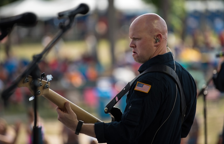Technical Sgt. Mike Wittrien, bassist with Max Impact, performs at the Armed Forces Tribute for the 2019 Suwannee River Jam. This event took place at the Spirit of the Suwannee Music Park on Saturday, May 4, 2019. (U.S. Air Force Photo by Chief Master Sgt. Kevin Burns)