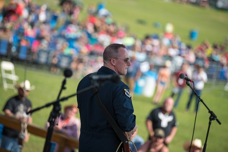 Senior Master Sgt. Matt Ascione, guitarist with Max Impact, performs at the Armed Forces Tribute for the 2019 Suwannee River Jam. This event took place at the Spirit of the Suwannee Music Park on Saturday, May 4, 2019. (U.S. Air Force Photo by Chief Master Sgt. Kevin Burns)