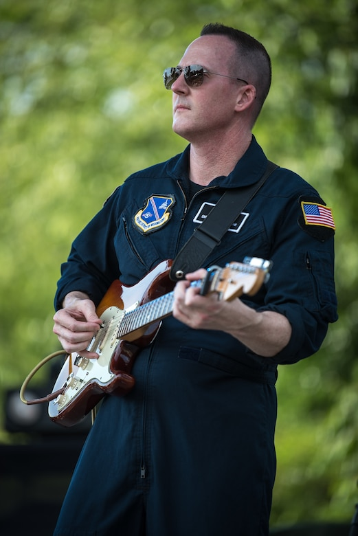 Senior Master Sgt. Matt Ascione, guitarist for Max Impact, performs for thousands of country music fans as part of the Armed Forces Tribute at the 2019 Suwannee River Jam. This event took place at the Spirit of the Suwannee Music Park on Saturday, May 4, 2019.