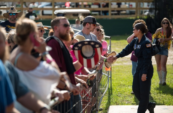 Lead vocalist of Max Impact, Technical Sgt. Nalani Quintello, visits with fans after performing for the Armed Forces Tribute at the 2019 Suwannee River Jam, which took place at the Spirit of the Suwannee Music Park on Saturday, May 4, 2019.