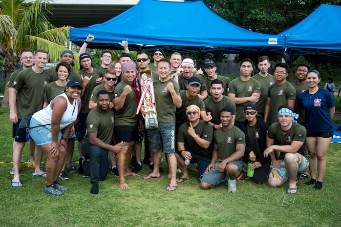 """The Single Marine Program dragon boat team poses with their trophy during the 45th Annual Naha Dragon Boat Race May 5, 2019 at Naha Port, Okinawa, Japan. Local and military communities participated in the famous race, also known as the """"Haarii."""" The SMP team won first place in the preliminary heat."""