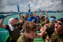 "The Single Marine Program dragon boat team celebrates their victory during the 45th Annual Naha Dragon Boat Race May 5, 2019, at Naha Port, Okinawa, Japan. Local and military communities participated in the famous race, also known as the ""Haarii."" The SMP team placed first in their preliminary heat."