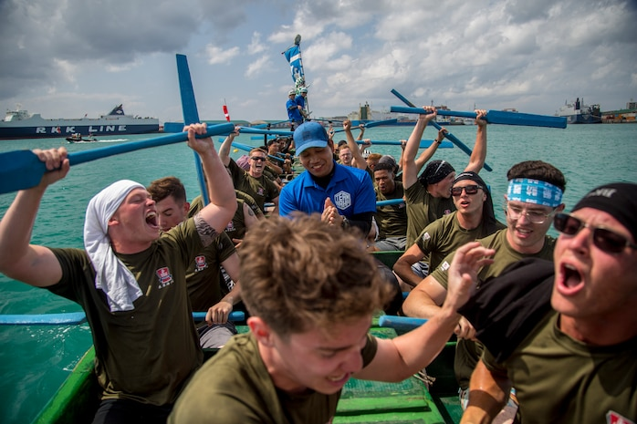 """The Single Marine Program dragon boat team celebrates their victory during the 45th Annual Naha Dragon Boat Race May 5, 2019, at Naha Port, Okinawa, Japan. Local and military communities participated in the famous race, also known as the """"Haarii."""" The SMP team placed first in their preliminary heat."""