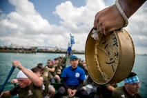 "The Single Marine Program dragon boat team rows in sync to the beat of the gong during the 45th Annual Naha Dragon Boat Race May 5, 2019, at Naha Port, Okinawa, Japan. Local and military communities participated in the famous race, also known as the ""Haarii."" The SMP team placed first in their preliminary heat."