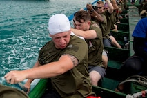 "The Single Marine Program dragon boat team rows in sync to gain the most speed during the 45th Annual Naha Dragon Boat Race May 5, 2019, at Naha Port, Okinawa, Japan. Local and military communities participated in the famous race, also known as the ""Haarii."" The SMP team placed first in their preliminary heat."