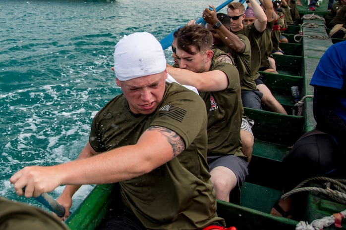 """The Single Marine Program dragon boat team rows in sync to gain the most speed during the 45th Annual Naha Dragon Boat Race May 5, 2019, at Naha Port, Okinawa, Japan. Local and military communities participated in the famous race, also known as the """"Haarii."""" The SMP team placed first in their preliminary heat."""