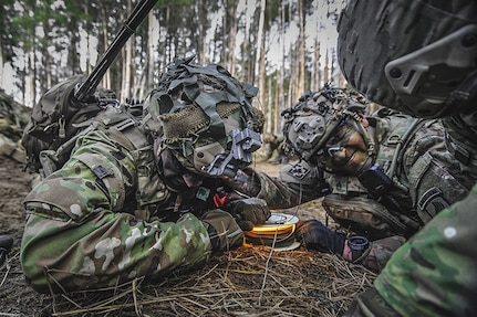 Paratroopers assigned to the 173rd Airborne Brigade, pull an M81 igniter to detonate a brazier charge during Exercise Rock Spring 19 at the Grafenwoehr Training Area, Germany, March 6, 2019.