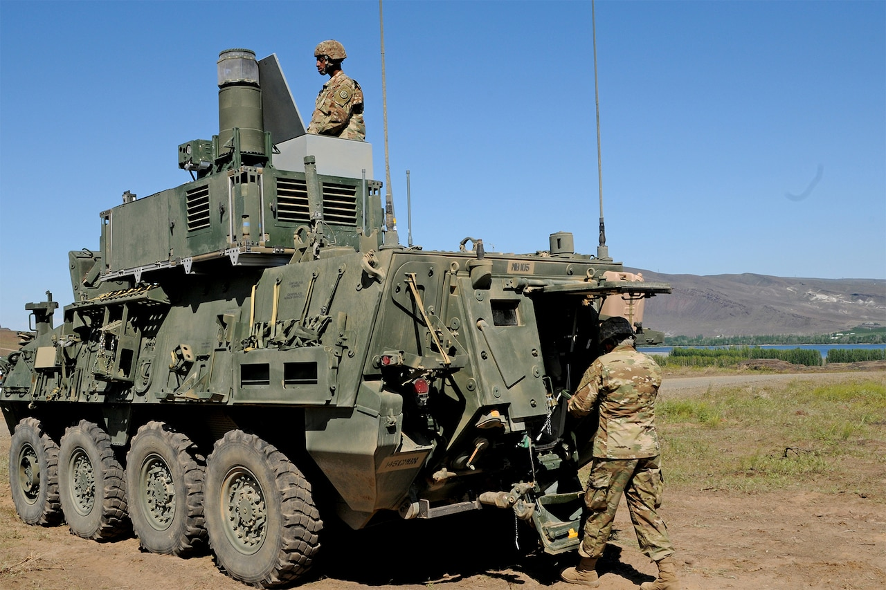 Soldiers work on a tactical vehicle.