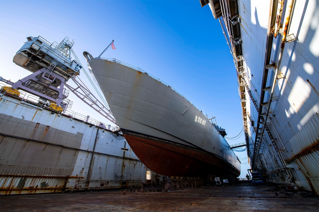 A ship rests in dry dock.