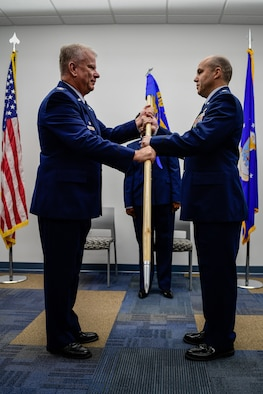 Lt. Col. Phillip Baker, the new 910th Civil Engineer Squadron commander, receives the 910th CES guidon from Col. Don Wren, commander of the 910th Mission Support Group, during a change of command ceremony, May 4, 2019, here.