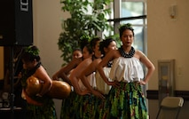 Members of the 808 Ohana of the Midwest dance group, led by Senior Airman Tiffany Ellison, 436th Supply Chain Operations Squadron, prepare to take the stage for a Hula performance on May 3, 2019, at Scott Air Force Base, Ill. The performance was a part of the Scott AFB Wingman Day Diversity Festival. (U.S. Air Force photo by Airman 1st Class Solomon Cook)