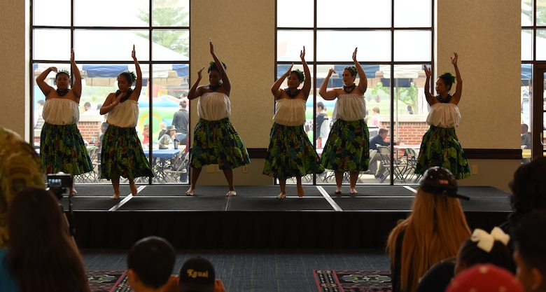 Members of the 808 Ohana of the Midwest dance group treat an audience to a hula performance on May 3, 2019 at Scott Air Force Base, Illinois. The performance was a part of the Scott AFB Wingman Day Diversity Festival. (U.S. Air Force photo by Airman 1st Class Solomon Cook)