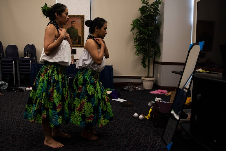 Keala Amorin and Senior Airman Tiffany Ellison, 436th Supply Chain Operations Squadron, prepare their outfits together prior to a hula performance on May 3, 2019 at Scott Air Force Base, Ill. Members of the 808 Ohana of the Midwest put on the performance as part of the Scott AFB Wingman Day Diversity Festival. (U.S. Air Force photo by Senior Airman Daniel Garcia)