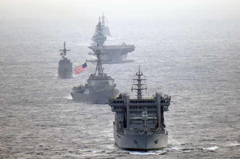Navy guided-missile destroyer USS William P. Lawrence (DDG 110), transits through international waters with the Indian Navy destroyer INS Kolkata (D 63) and tanker INS Shakti (A 57), Japan Maritime Self-Defense Force helicopter-carrier JS Izumo (DDH 183) and destroyer JS Murasame (DD 101), and Republic of Philippine Navy patrol ship BRP Andres Bonifacio (PS 17) through the South China Sea.