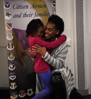 Tech. Sgt. Jocilyn Grable hugs her daughter April 26, 2019, during a Yellow Ribbon Reintegration Program training weekend in Chicago. Grable, 507th Air Refueling Wing Development and Training Flight program manager at Tinker Air Force Base, Oklahoma, deployed to Southwest Asia July 2017 to January 2018. (U.S. Air Force photo by Tech. Sgt. Samantha Mathison)