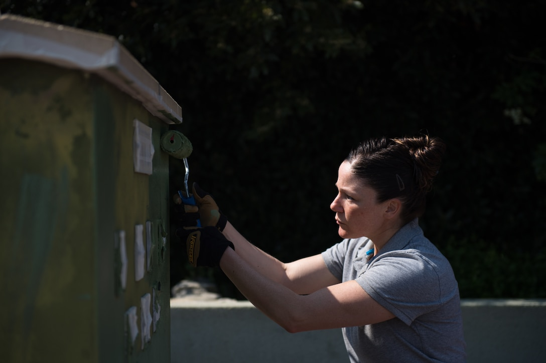 U.S. Air Force Master Sgt. Meghan Donahue, 435th Construction Training Squadron first sergeant, refurbishes a WWII memorial with new paint in Picauville, France, April 30, 2019. The memorial is used for ceremonial events hosted every year for the anniversary of D-Day. Donahue and her team ensured it would be presentable this year. (U.S. Air Force photo by Staff Sgt. Devin Boyer)