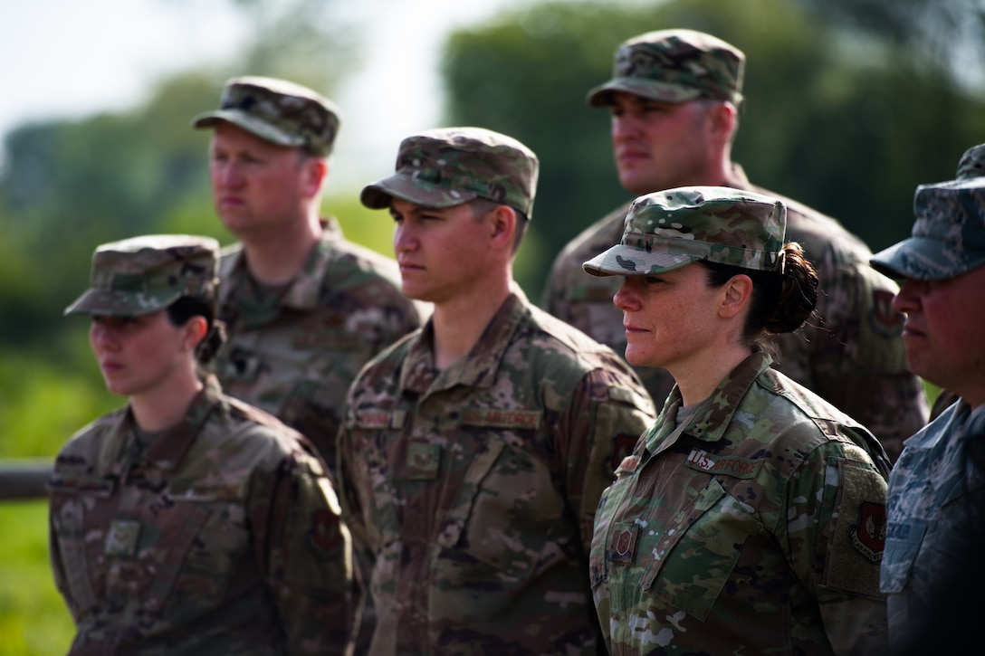 U.S. Air Force Airmen assigned to the 435th Construction Training Squadron, stand at parade rest during a ceremony at a WWII memorial in Picauville, France, May 1, 2019. The mayor of Picauville and the organization that oversees the memorial recognized and gave thanks to the Airmen who refurbished the memorial. (U.S. Air Force photo by Staff Sgt. Devin Boyer)