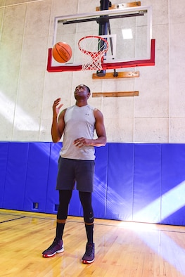 """Towering above most, Akinyemi Solanke, a structural apprentice with the 434th Civil Engineer Squadron, is right at home under the basket May 5, 2019 at Grissom Air Reserve Base, Indiana. The 6'11"""" native of Nigeria hopes to earn a roster spot with the All-Air Force men's basketball team. (U.S. Air Force photo/Staff Sgt. Chris Massey)"""