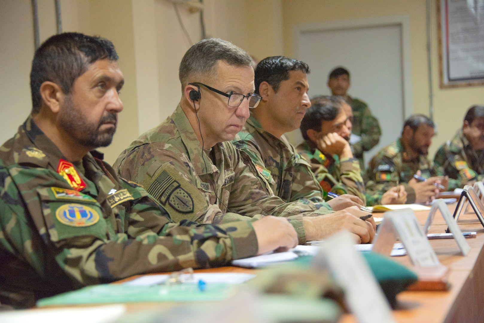 Brig. Gen. Scott Jackson, left center, commander of the 1st Security Force Assistance Brigade, attends an Afghan-led battle update briefing Sept. 18, 2018. Jackson and other advisors in his brigade often attend the briefings near his command headquarters at Advising Platform Lightning to offer their insight to counterparts. (Photo Credit: Sean Kimmons)