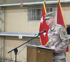 Col. Jeffrey McCarter, 8th Medical Brigade commander, speaks to the audience during the transfer of authority ceremony for United States Military Hospital - Kuwait at Camp Arifjan, Kuwait, May 6, 2019.