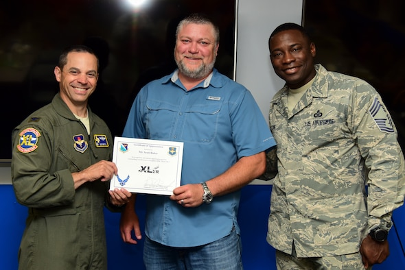 "Scott Baker, 47th Communications Squadron telecommunications manager, was chosen by wing leadership to be the ""XLer"" of the week, for the week of April 29, 2019, at Laughlin Air Force Base, Texas. The ""XLer"" award, presented by Col. Lee Gentile, 47th Flying Training Wing commander, is given to those who consistently make outstanding contributions to their unit and the Laughlin mission. (U.S. Air Force photo by Airman 1st Class Anne McCready)"