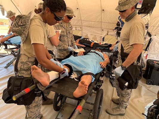 Airmen from the 156th Medical Group treat simulated mass casualties during Exercise Vigilant Guard in Puerto Rico, March 14, 2019. The 156th Airlift Wing transitioned to the 156th Wing April 10 to sync with the unit's newly assigned contingency response and combat communications missions.